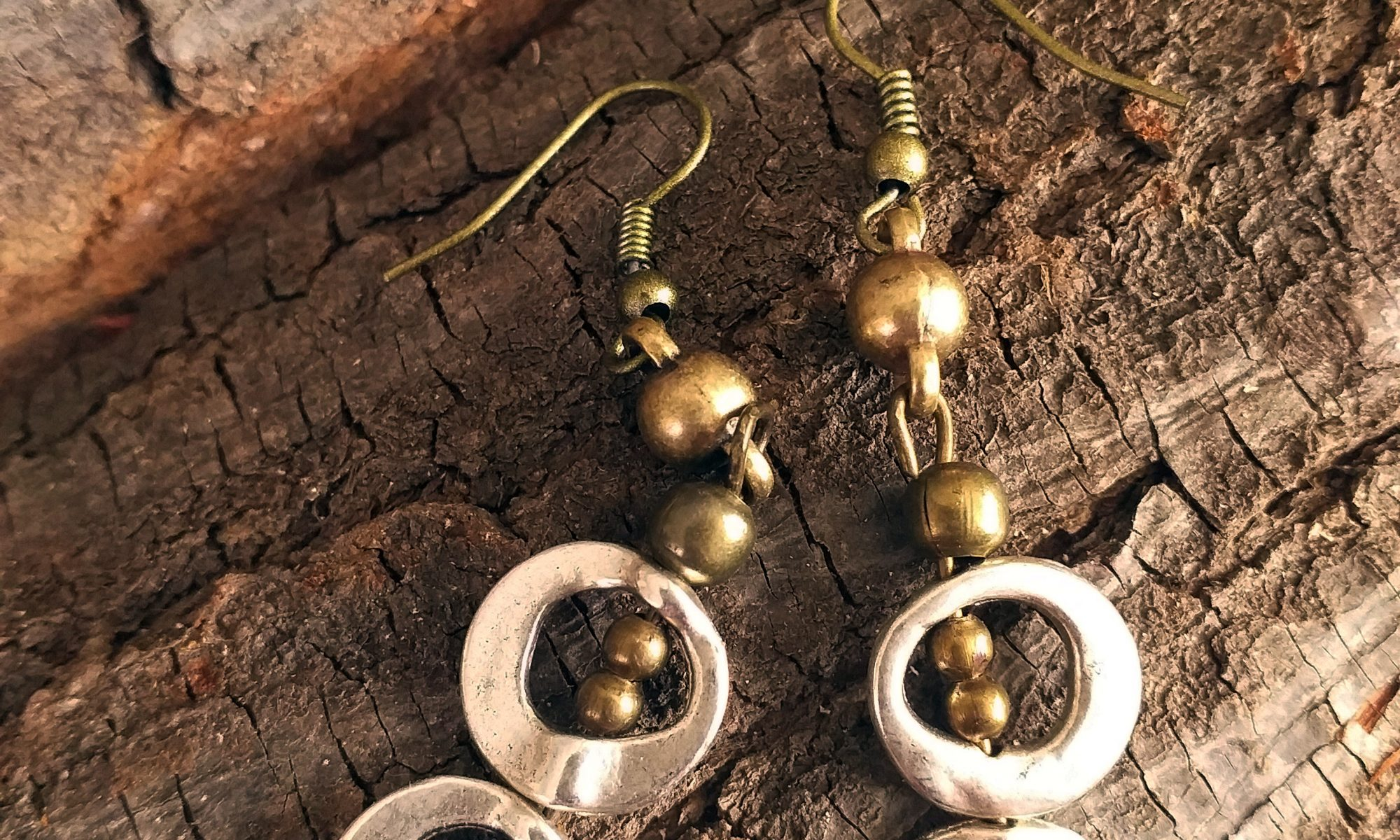 silver and brass double ring earings